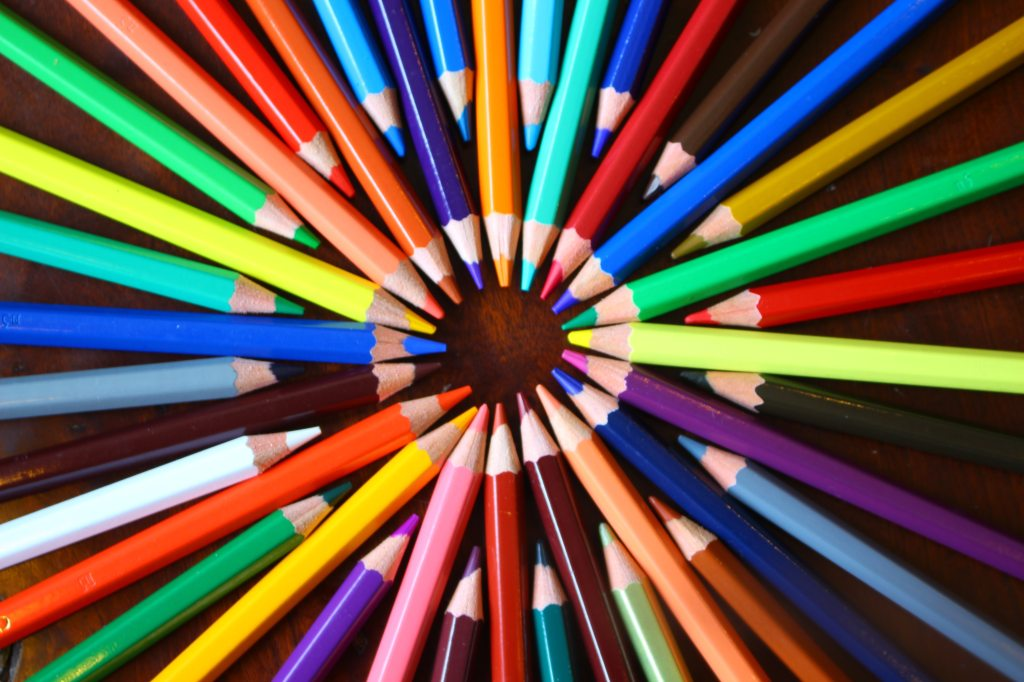 Picture of colourful pencils making a pattern.